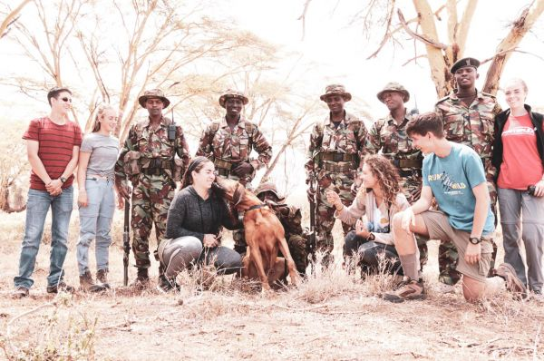 Students with anti-poaching sniffer dog team
